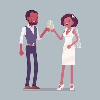 La sposa e lo sposo godono di un drink durante la cerimonia di matrimonio
