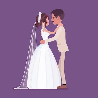 Sposa e sposo in dolce abbraccio sulla cerimonia di matrimonio