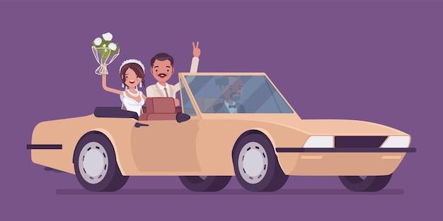 Sposa e sposo in auto di lusso sulla cerimonia di matrimonio