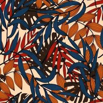 Modello senza cuciture astratto luminoso con le foglie e le piante tropicali variopinte su beige