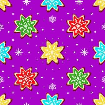 Motivo luminoso con biscotti allo zenzero sotto forma di fiocchi di neve su sfondo viola