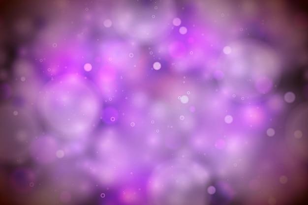 Luci magiche viola brillanti nel buio, sfondo bokeh astratto