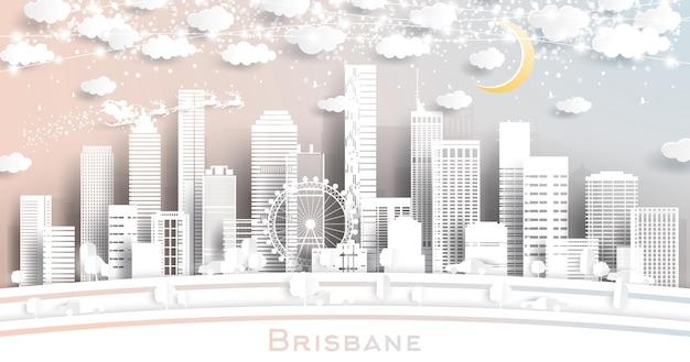 Skyline della città di brisbane australia in stile taglio carta con fiocchi di neve, luna e ghirlanda al neon neon