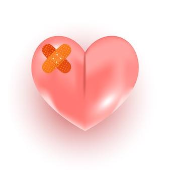 Forma di cuore rosa spezzato con benda su sfondo bianco, vista dall'alto. spazio per il testo