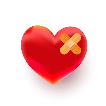 Forma di cuore rosso spezzato con bendaggio su sfondo bianco, vista dall'alto. spazio per il testo