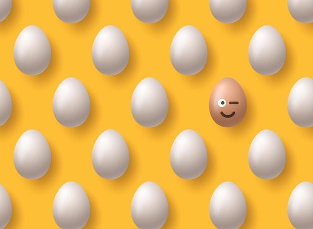 Sorriso di emoji marrone realistico delle uova di pasqua su giallo