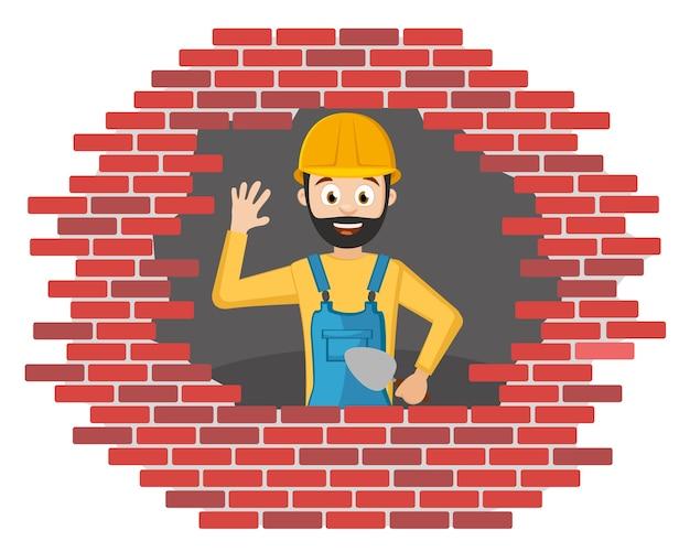 Il costruttore in un casco costruisce un muro di mattoni su uno sfondo bianco.
