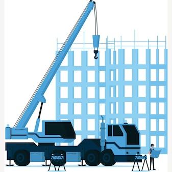 Uomo del costruttore che guarda la mappa di costruzione davanti all'illustrazione del gancio della gru di costruzione