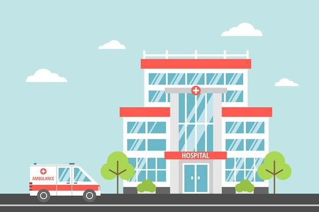 L'edificio dell'ospedale cittadino con un'ambulanza in stile cartone animato piatto