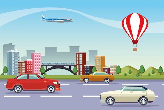 Paesaggio urbano di edifici con strada e mezzi di trasporto