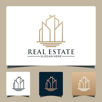Design del logo immobiliare degli edifici con lago e colore dorato