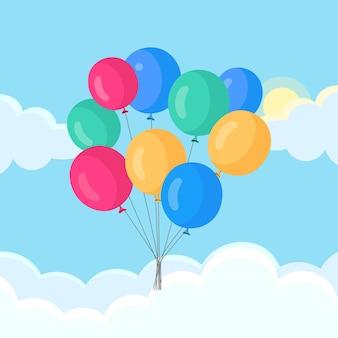Mazzo di palloncini ad elio, palloni d'aria che volano nel cielo.