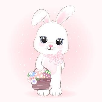 Bunny tenendo le uova nel cestello, il giorno di pasqua concetto