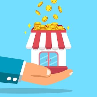 Grandi soldi dei guadagni della mano di affari con il negozio di affari