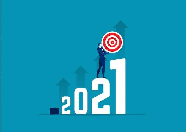 Obiettivo della tenuta di affari all'illustrazione di concetto del nuovo anno 2021.