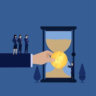 Il direttore commerciale dà il pagamento per la metafora del tempo di sabbia di tempo è denaro.