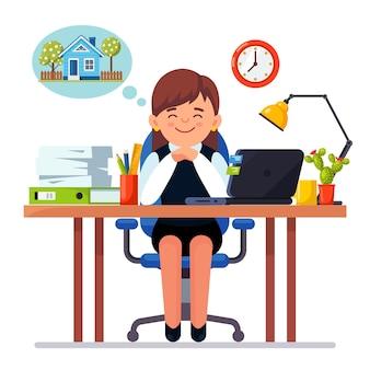 La donna d'affari è rilassante e sogna una nuova casa, casa sul posto di lavoro con laptop, lampada, documenti