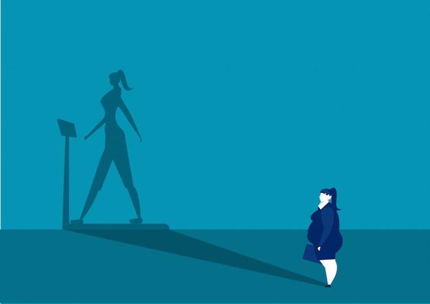 Donna di affari che guarda il suo futuro esile della misura dell'ombra