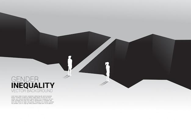 Uomo d'affari e donna d'affari di fronte alla valle e l'uomo con il ponte. concetto di disuguaglianza di genere negli affari e ostacolo nel percorso di carriera della donna
