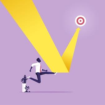 Uomo d'affari cambia grafico a linee nel grafico del percorso di destinazione per indirizzare l'aspirazione alla vittoria
