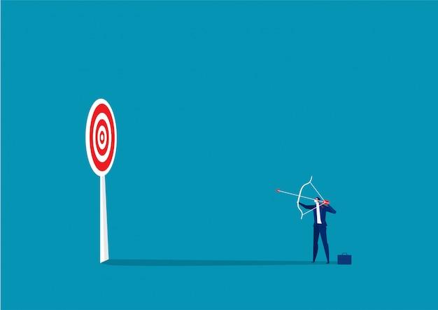Obiettivi di tiro con l'arco di carattere dell'uomo d'affari
