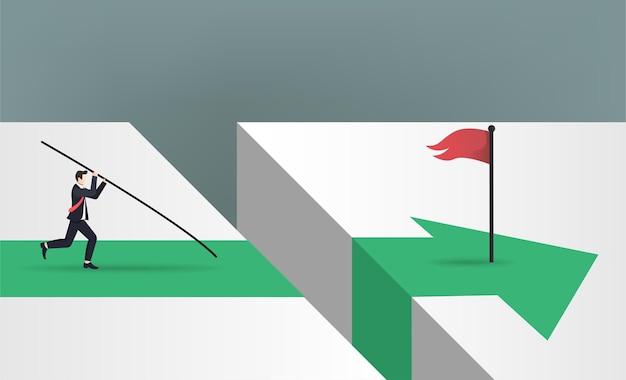 Uomo d'affari che fa salto con l'asta per saltare sopra la bandiera rossa con il concetto di direzione della freccia verde.