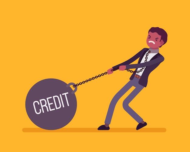 Uomo d'affari trascinando un peso credito sulla catena