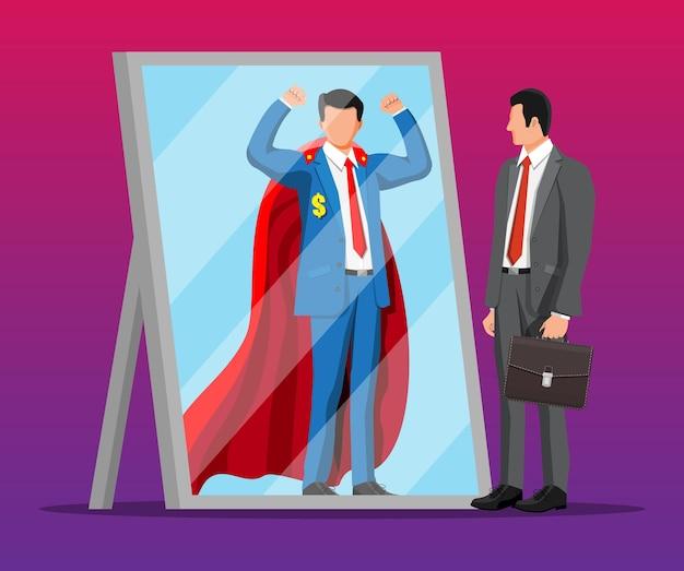 Uomo d'affari che affronta se stesso come supereroe nello specchio. ambizione aziendale e concetto di successo.