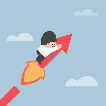 Uomo d'affari sul grafico crescente, concetto di successo