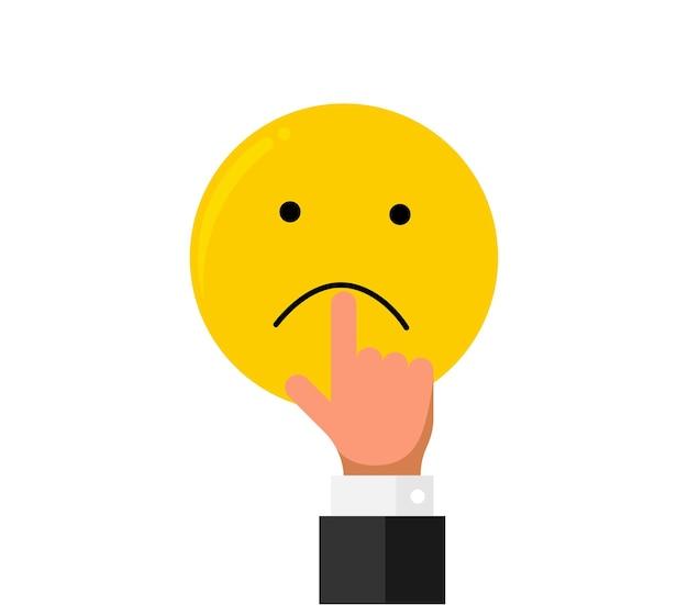 L'allungamento del dito della mano dell'uomo d'affari tira sulle labbra della bocca sull'emozione triste di smiley emoji come valutazione. stile piano di concetto di recensione di cliente di qualità di reputazione di feedback online. illustrazione vettoriale eps
