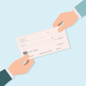 Mano di uomo d'affari che dà assegni bancari in bianco ad altra persona.