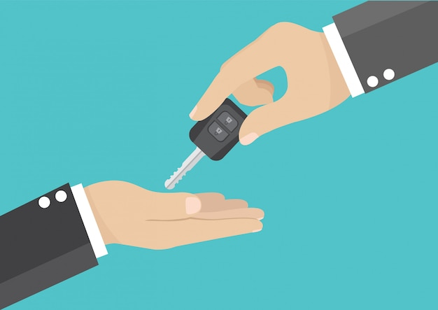 Mano dell'uomo d'affari fornendo la chiave dell'automobile