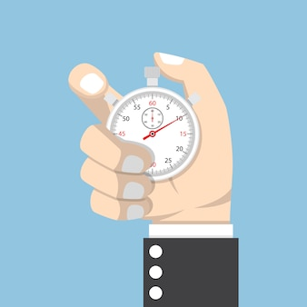 Cronometro della tenuta della mano dell'uomo d'affari