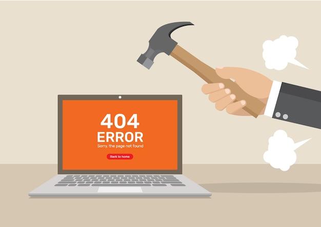 Computer fracassato turbato della mano dell'uomo d'affari.