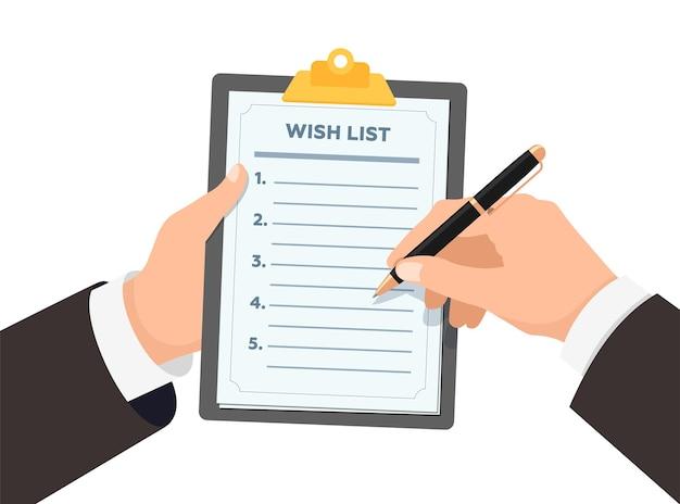 Mani dell'uomo d'affari che tengono gli appunti con la lista dei desideri l'uomo d'affari con la penna scrive i desideri su carta