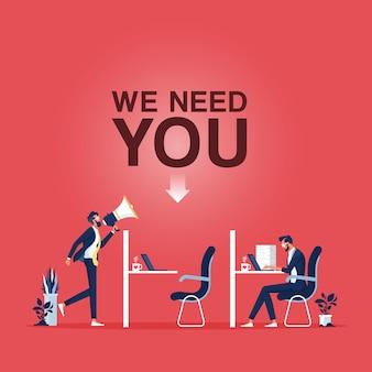 Megafono della holding dell'uomo d'affari con la parola abbiamo bisogno di te