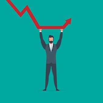 L'uomo d'affari tiene un grafico che cade. il concetto di salvare un'azienda dal default