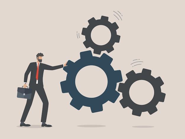 L'uomo d'affari ha messo gli ingranaggi, il concetto di soluzione aziendale Vettore Premium