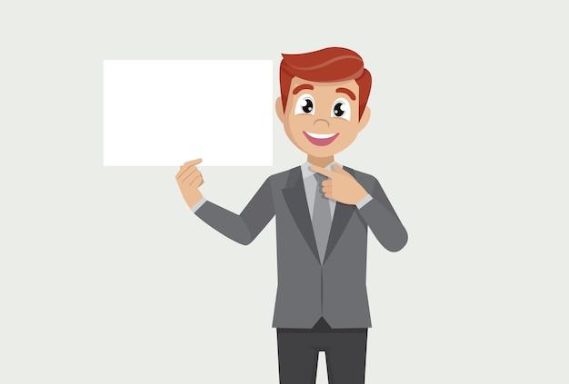 Uomo d'affari che mostra manifesto bianco in bianco e dito puntato