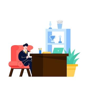 L'uomo d'affari si siede sulla scrivania