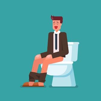 Uomo d'affari che si siede sulla tazza della toilette
