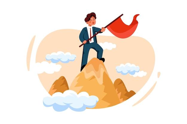 Imprenditore in piedi e tenendo la bandiera sulla cima del picco
