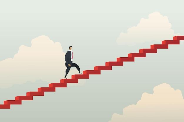 Uomo d'affari che cammina salendo le scale rosso