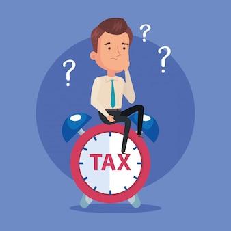 Uomo d'affari con la sveglia del giorno delle tasse