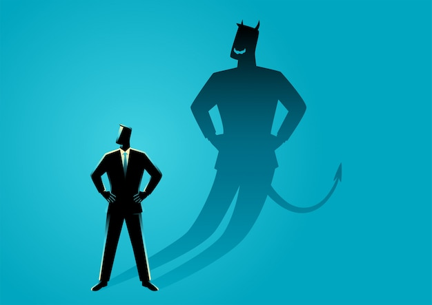 Uomo d'affari con la sua ombra del diavolo