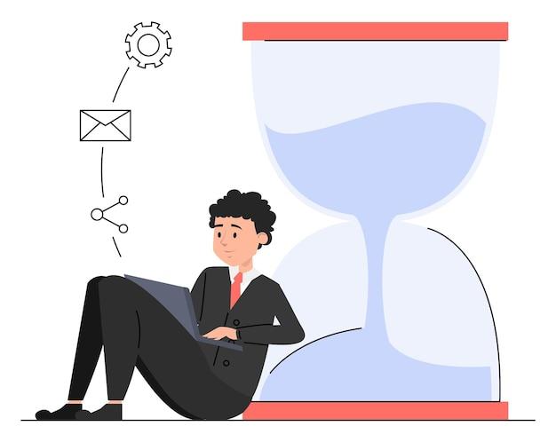 Uomo d'affari con laptop seduto alla clessidra