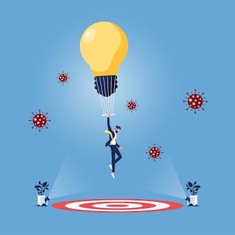 Uomo d'affari con il fuoco della lampadina del paracadute sull'obiettivo superare la crisi