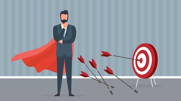 L'uomo d'affari con un mantello rosso colpisce l'obiettivo.