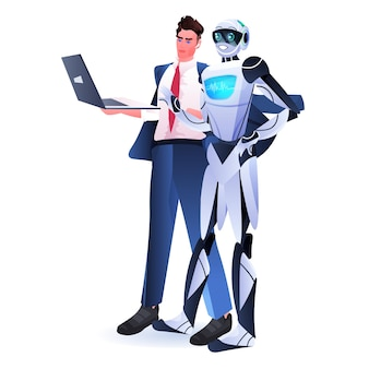 Uomo d'affari con il robot che utilizza il concetto di tecnologia di intelligenza artificiale del computer portatile