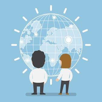 Uomo d'affari e donna in piedi davanti al concetto di mondo, comunicazione e tecnologia digitale